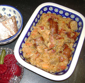 Kielbasa and sauerkraut served with sweet beets and brown bread